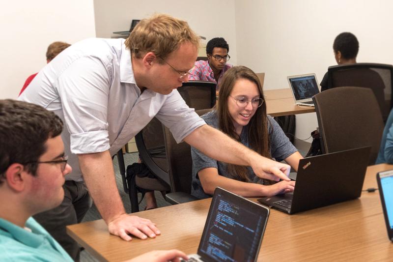 Scott Enderle working with an undergradute