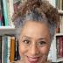 Zita Nunes standing in front of a bookshelf